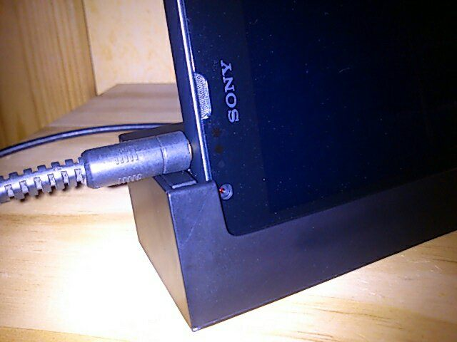 Plug in earphones while Xperia SP is on Dock