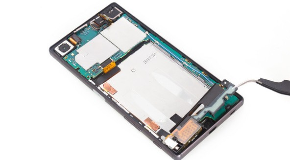 loosen the bottom side of main flex assembly on Xperia Z5